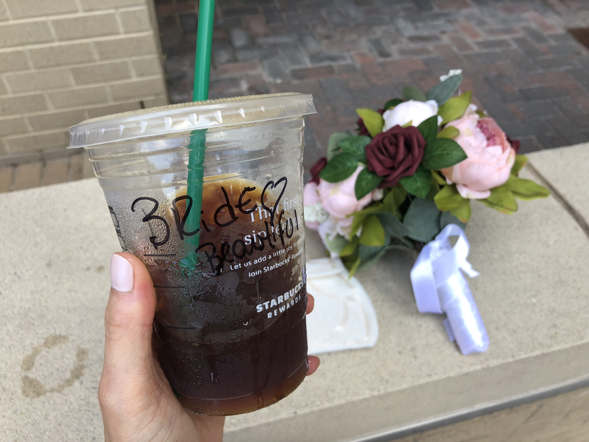"""My wedding day iced coffee with """"Bride"""" written on the cup"""